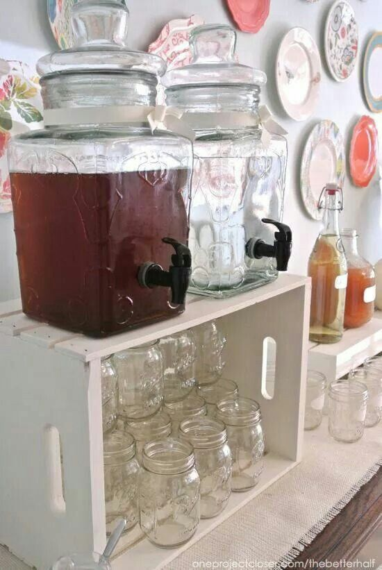 "Ball jar ""drinking glasses"" in crate with beverage dispensers on top. From my twisted armoire- great idea for a party!"