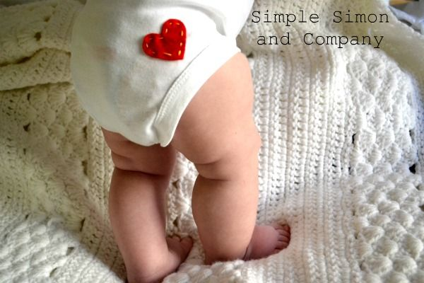 sew on a simple little heart to the back of a baby's onesie. aww.