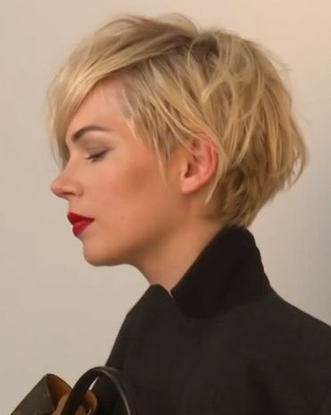 Michelle Williams, messy side view of her pixie, grown out a little, a nice honey blonde - can we say, yes please