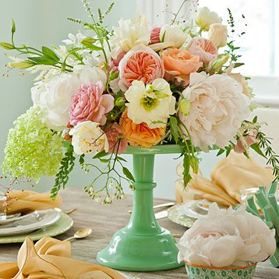 """Upcycle an op-shop cake stand by painting it in your wedding colour scheme and topping it with your floral arrangements. It has the added bonus of making a little extra table space on small tables! 