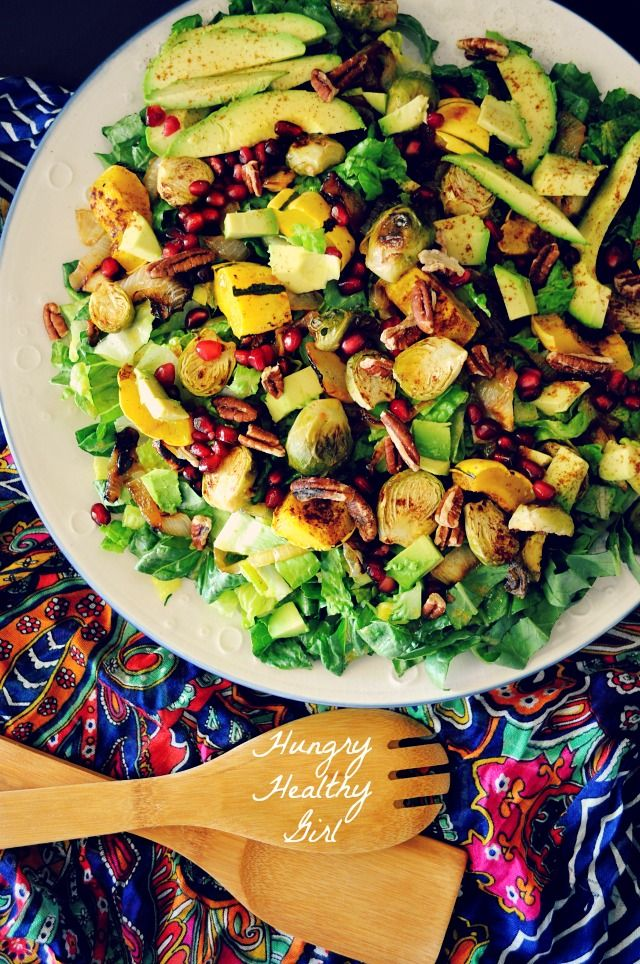 Autumn Harvest Salad with Roasted Squash, Brussels Sprouts, Caramelized Onions and topped with a sweet maple vinaigrette.