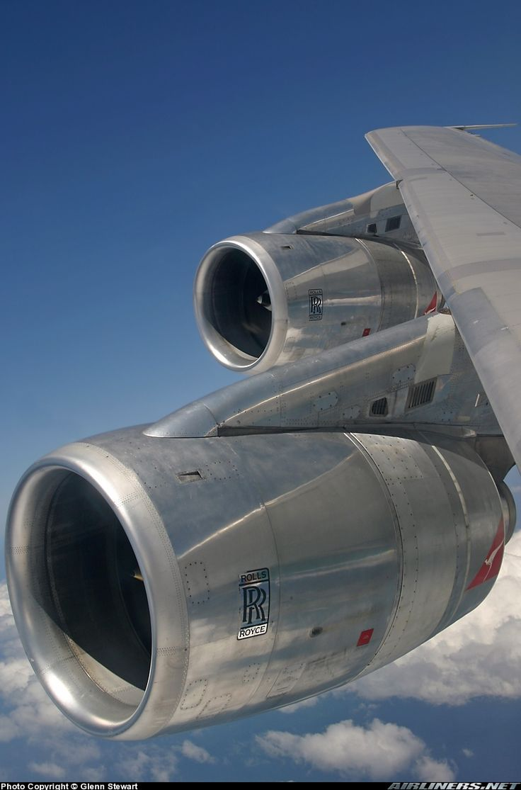 The beautiful inflight view of 2 out of 4 Rolls Royce RB211-524C turbofans on a Qantas Boeing 747-338; note the bare metal engines