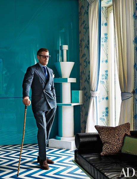 Entrepeneur and designer Lapo Elkann in the living room of his Milan apartment, which was renovated and decorated with Studio Natalia Bianchi; the totem is by Ettore Scottsass.