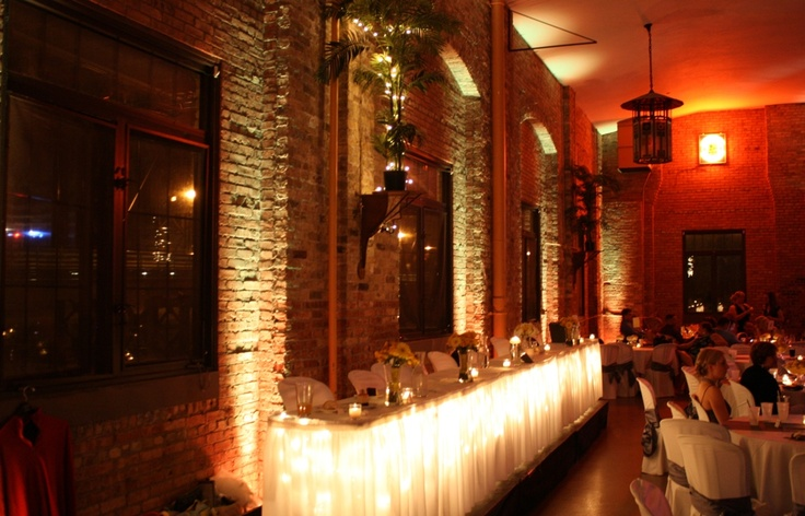Yellow Uplighting Provided By All Star Music For A Wedding Reception At Lakefront Brewery In Milwaukee WI