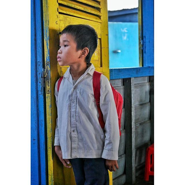 Portrait of an orphan boy captured at a school in the floating village in Siem Reap. His parents were killed in a storm five years ago. Natural disasters, especially heavy rains causing floods, are not only leading to loss of human lives but are also a factor of displacement in Cambodia.  #portrait #children #siemreap #cambodia #exploretocreate #explore #naturaldisaster #photojournalism #phototravel #travelgram #travel #traveler #traveling #travelingram #instatravel #igtravel