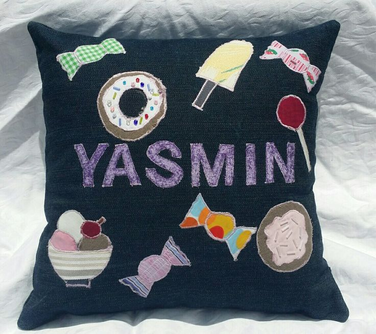 Denim applique throw pillow. Candy themed.