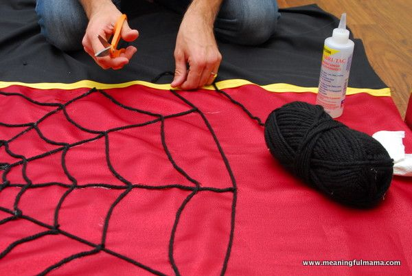 superhero backdrop for party | Then, I used yarn and fabric glue to attach the web to the guidelines ...
