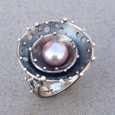 Large Galaxy style ring set with a pink freshwater pearl. Janet Scherrer