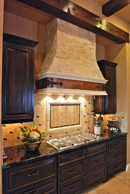 Stone tile hood with metal hinge plates. I appreciate the high ceilings in this kitchen.  My dream kitchen would have 18-ft high ceilings, this exhaust hood, and a skylight.  #LGLimitlessDesign, #Contest.
