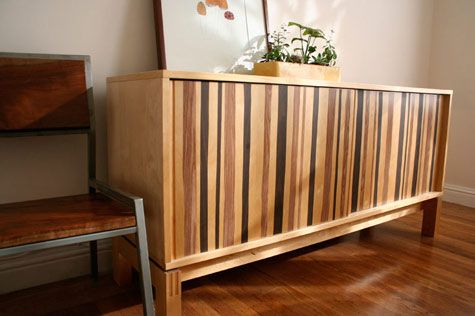 Derek and Lauren recently posted on Design*Sponge about how they updated their plain IKEA credenza using little more than two shades of woodgrain contact paper. The effect is modern and fun at the same time. Link.