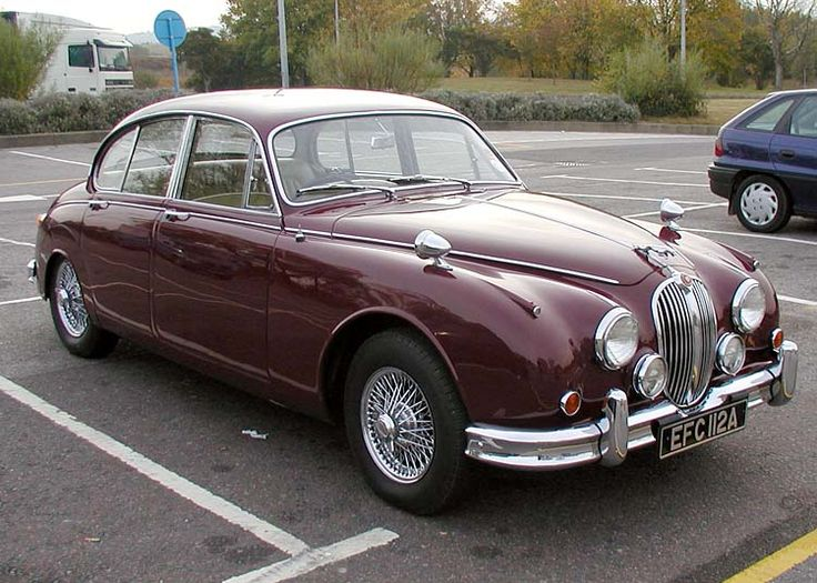 Jaguar Mark II - a neighbor had two of these sitting in the field behind their home - my first automotive obsession (they became flowerpots over time)