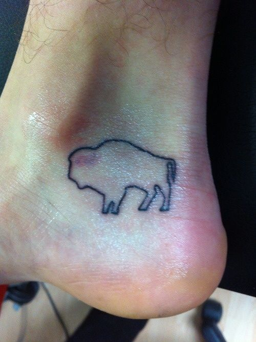 I want to get a Buffalo Tattoo but I would like to have it all colored in black.