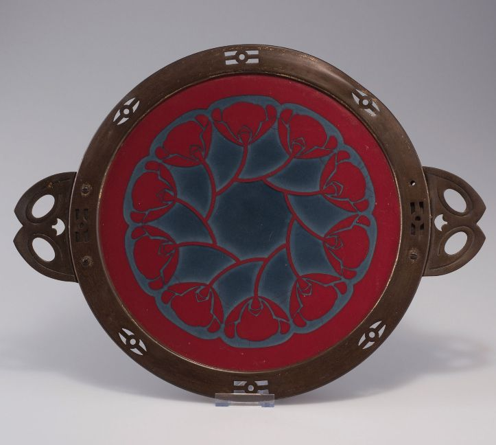 Secessionist cake platter, manufactured by Wächtersbach, Schlierbach, c1906. 44.5 x 34.3 cm. Designed by Christian Neureuther. Earthenware, glazed raspberry red and blue grey. Marked: Artist's signet, 820.  |  SOLD 350 EUR