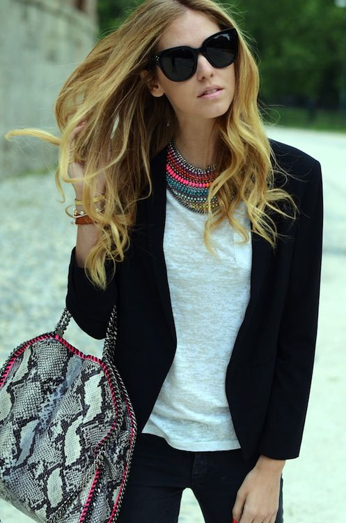 Dress up a casual tee with a statement necklace and blazer