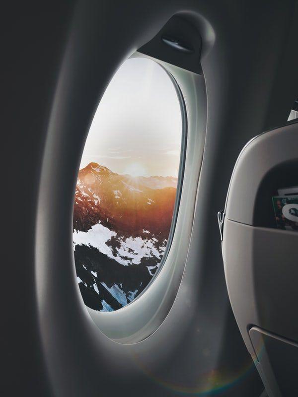 Plane Window Showing Mountain Travel Pictures Plane Window Travel Around The World