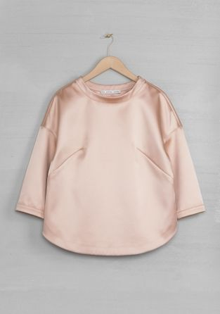 http://www.stories.com/Ready-to-wear/Tops/Glossy_structured_top/582942-594860.1