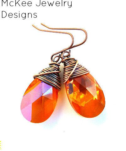 These earrings are made from Swarovski crystal, Astral Pink or orange pink mixed, 16 mm faceted pear shape pendants and with antiqued copper wire wrapping. The magnificent color and sparkle of these crystals bestow enchanting elegance upon any jewelry piece. Their outstanding quality is the result of special polishing, perfect cut, exact geometry and precise angles, which draw out maximum brilliance. *these are small earrings**  Copper earring wire Antiqued copper wire wrapping Swarovski…