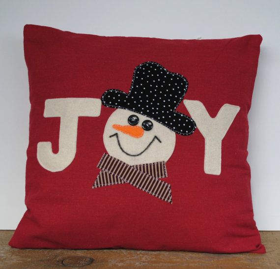 This is a beautiful 18x18 Christmas pillow cover, made with home decor dark red linen fabric with a off white lettering and snowman on the