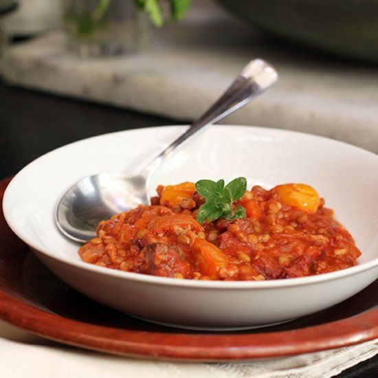 Rich, tomato, lentil, and ground veal stew with chourico mouro.