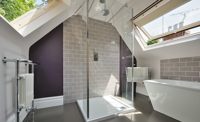 Not only is this bathroom remarkably beautiful, but it feels oh so private with the rooftop windows.