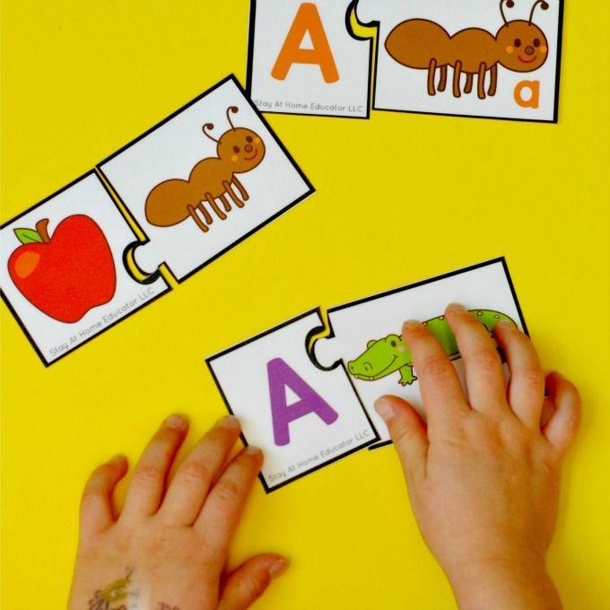 Preschool Phonics Centers - Letter matching and beginning sound puzzles.