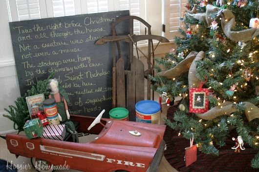 using a chalk board to write a carol or verse would be cute; also like the burlap woven through the tree and the vintage car