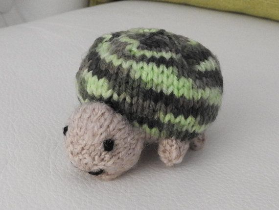 Hand knitted super cute tortoise critter. Mind you, he'll not appreciate being left lying on his back - it's a little difficult for him to turn back over.