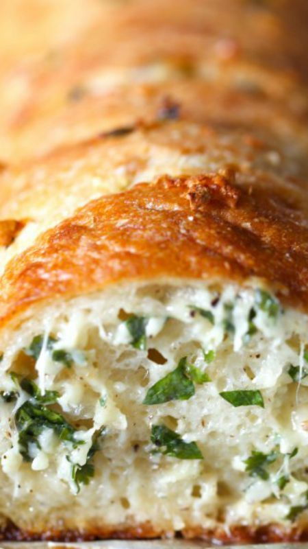 Epic Stuffed Garlic Bread ~ The best... It's buttery, cheesy and LOADED with fresh garlic!