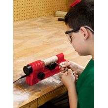 Young carpenters can safely create and build real wooden projects using this combination drill press, jigsaw, sander and lathe. Woodworking equipment functions and performs like real carpentry machinery, but with rigorous built-in safety features to protect kids from the possibility of injury. The 4-in-1 Cool Tool Workshop with Accessories and Booklet includes equipment, wooden practice dowels, 4 wood samples, power supply and deluxe project book, as well as extra blades, sanding disks and…
