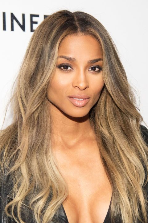 Ciara softens her jet-black hair with cool blonde highlights.