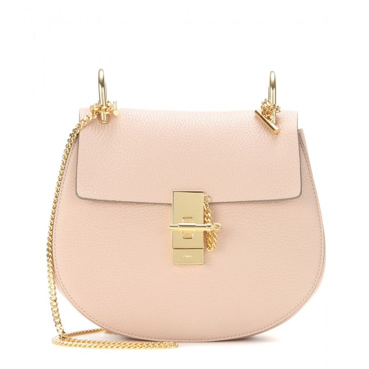 Chloé - Drew leather shoulder bag - The 'Drew' from Chloé is one of the house's most coveted signatures, and it's a sure-fire way to ignite style envy. The curved silhouette is complemented by a luxurious brushed suede interior and jewellery-inspired hardware. Let the ever-chic pale pink hue and gold-toned accents stand out next to neutrally hued separates. seen @ www.mytheresa.com
