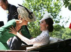 Catherine, Duchess of Cambridge catches a falling Sophie, Countess of Wessex as they arrive at the Royal Ascot, 2017