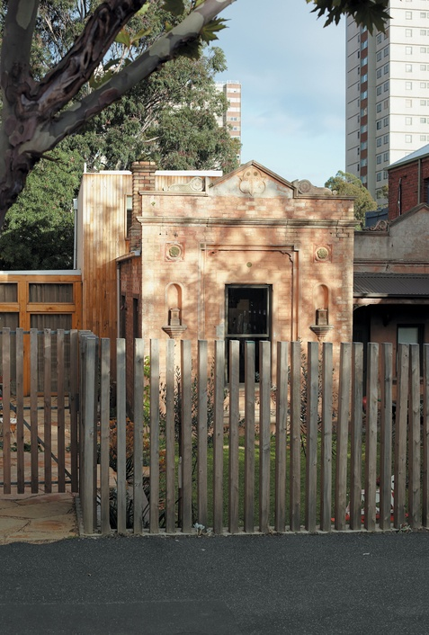 """On a shady street just off the main drag of Melbourne, Australia's hippest inner suburb, a pair of creative types and their two kids have made a bright, cheery home by renovating an 1860s stable, oddly named """"Villa Boston."""""""