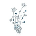 Brooch in platinum with round brilliant diamonds and aquamarines. Round brilliant diamonds, carat total weight 3.15; round aquamarines, carat total weight 1.35.