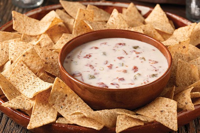 Combine two ingredients in eight minutes for one smiling crowd with this queso blanco dip. This VELVEETA Queso Blanco Dip is one great appetizer.