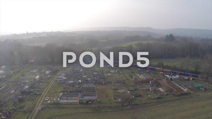 2.7K Aerial Shot Train Traveling By Field Woodland Countryside Farm Plots Drone - Stock Footage | by RyanJonesFilms