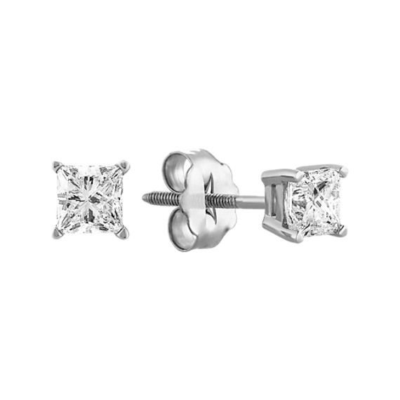 These classic princess-cut diamond solitaire earrings are perfectly matched, by hand, for beauty and brilliance. These brilliant diamonds are graded H-I (near colorless). The earrings are set in 14 karat white gold with safety backs for added security.