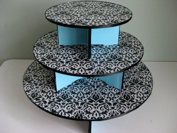 Cupcake stand - I could totally make this with scrapbooking paper!...Just another great reason to buy more paper. =)