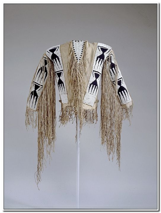 Man's shirt: probably Jicarilla Apache (attributed)    Date created:  1850-1880 Place:  Arizona; USA Media/Materials:  Hide, glass pony beads, sinew, cotton thread Techniques:  Sewn, lazy/lane stitch beadwork, fringed