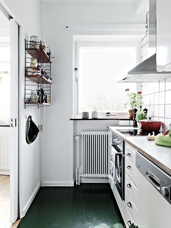 Green Painted Floor Kitchen Remodelista - A wood floor painted green in a Scandinavian home via Stadshem.