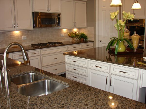 Brown granite in a beautiful white kitchen in a model home in Waldorf, Maryland: www.MariaStrong.net