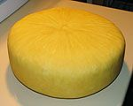"""Jack Cheese Recipe: """"This is about as simple a cheese as you can make... it requires no forms, no press, and about as little effort as a cheese can be. Some milk, a pot, a piece of porous cloth, a couple of boards and a rock."""" The unwaxed cheese is aged 3-8 months with a coating of olive oil."""