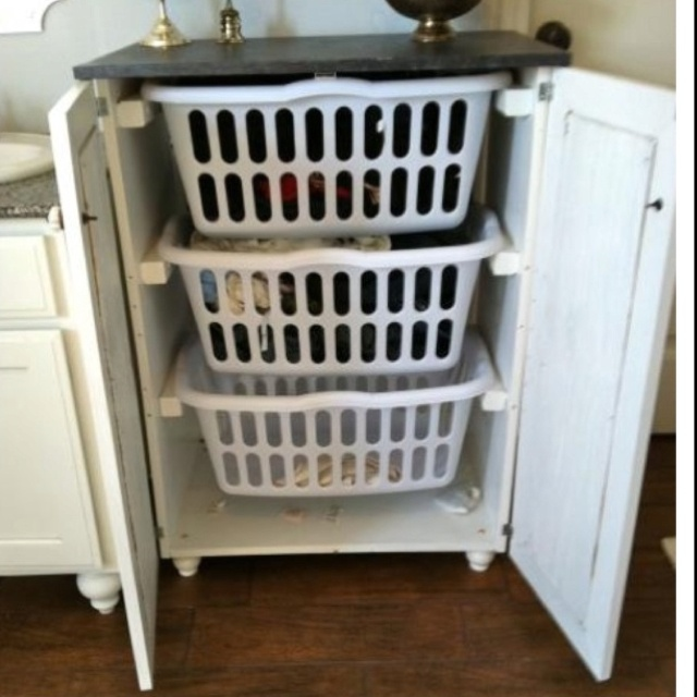 Hideaway laundry baskets! So much better than on top of the dryer or on a shelf!