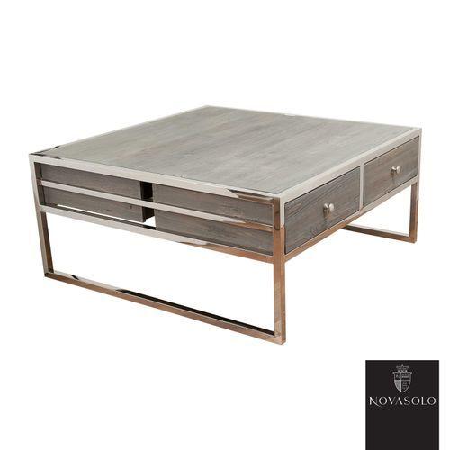 Råtøft Frost sofabord produsert i en kombinasjon av resirkulert, gråvasket furu og blankpolert rustfri stål!Treverket er resirkulert som betyr at kvister, sprekker, skjevheter og andre mindre defekter er en bevisst og naturlig del av produktet - hvert enkelt møbel vil være helt unikt og ha sin egen sjarm! Fargevariasjoner vil forekomme innad på hvert møbel og fra produkt til produkt.Mål:Bredde 100 cmDybde 100 cmHøyde 45 cmMaterialer:Resirkulert, gråvasket furuBlankpolert ru...