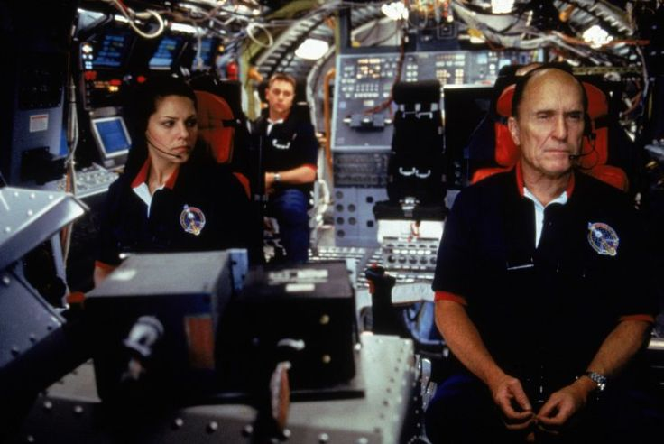 Robert Duvall, Mary McCormack, and Jon Favreau in Deep Impact (1998)