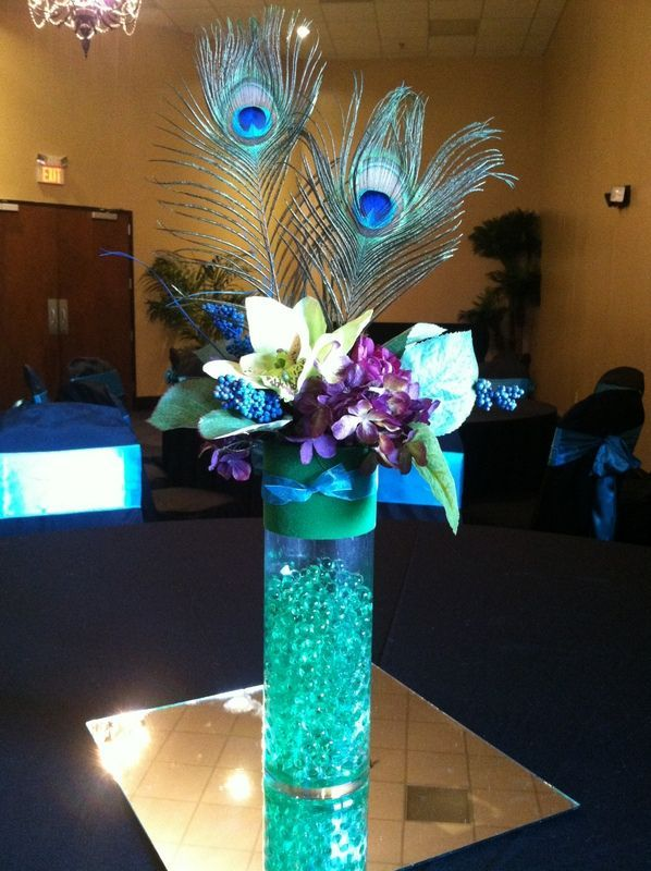 Center pieces. With branches instead of the feathers. And darker blue...
