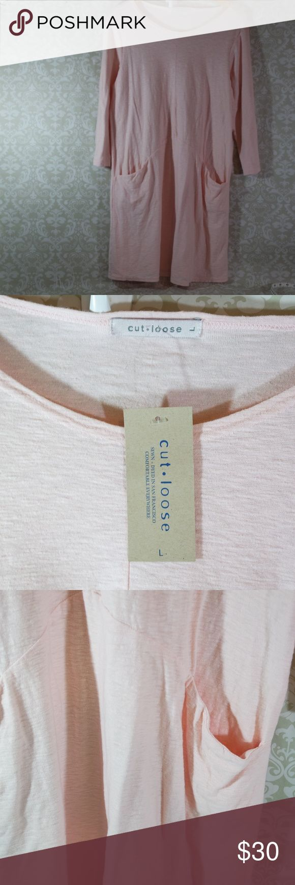 NWT Pink Cut Loose Casual Dress Size L New with tags casual pink dress by Cut Loose.  70% Cotton  30% Linen.  Two front pockets.  Perfect weekend dress.  Stylish yet comfortable.  Knee length.  200118M Cut Loose Dresses Midi