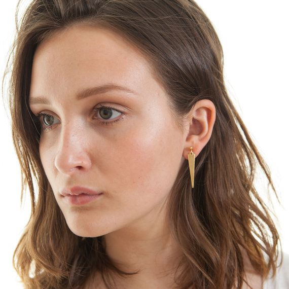 The perfect minimalist gold earrings - simple yet modern with geometric triangle shapes and on-trend raw brass.  The long, skinny triangle pendants are lightweight and cut from raw brass giving them a beautiful, slightly matte effect. They hang from gold plated, nickel free ear studs.  Contemporary dangling earrings that are simple enough to wear day or night!  Brass will naturally oxidise over time but its shine can be restored by simply buffing the triangles with a soft cloth and brass…