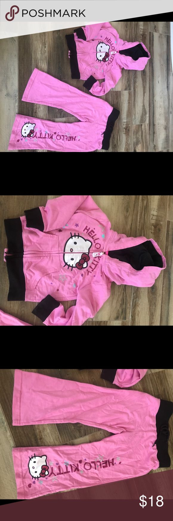 Hello Kitty Track Suit - Size 3T Perfect in pink, adorable Hello Kitty Track Suit! Size 3T. In perfect condition! Glitter accents! Zip up with attached hood and drawstring on bottoms. Lightweight, yet keeps the little princess super warm on park nights! Love the adorable comfy Hello Kitty design! 🖤 Hello Kitty Matching Sets