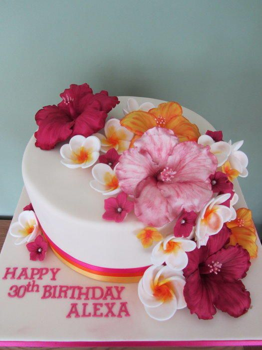 A 10 inch cake made for my parents God daughter (does that make her my god sister?!) She was due to be wearing a gorgeous top featuring loads of tropical flowers on it, so thats where i got my inspiration! It combines hibiscus, frangipani and...